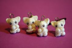 White or tabby polymer clay kitten charm by OYuRikoO on Etsy, $3.20
