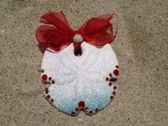 A large embellished arrowhead sand dollar by LaJollaShellWorks