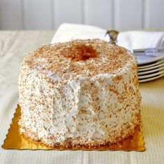 Pina Colada Cake - a really great vanilla cake recipe gets soaked in a little dark rum, filled with a couple of layers of roasted pineapple jam and covered in a thick layer of coconut marshmallow frosting before being garnished with a final sprinkle of toasted coconut. This is an awesome celebration cake for those who love sweet, tropical, pineapple flavor but I'll bet the coconut lovers will go wild for this one too.