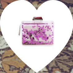 Vogue.it | Love of the week: the glittered clutch by Kotur | #Globe . It's time to breathe deeply the fresh air of Spring, a girly, flirty air. Ban all kind of severity is the season's motto and our suggestion– glittering, verging on Barbie-like – is too choose odd, extravagant details.Perfect for small and big dolls, the clutch by Kotur is not a decorative object (like the one you liked to shake when you were kids) but the accessory that will make even the simplest ensemble look edgier...
