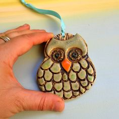 This is a lovely green and brown ceramic owl, a wall hanger clay owl.  It is a great home or office wall hanging decoration which is great as Christmas
