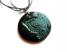 Mehndi necklace, stamped polymer clay jewelry in teal and black, disk pendant, yoga jewelry. $19.00, via Etsy.
