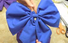 How to make a costume/Christmas bow. There is no intro on what pieces you need before hand, or what measurements to use, but it gets the idea across