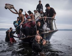 Refugees arrive by a Turkish boat near the village of Skala, on the Greek island of Lesbos (The New York Times/Sergey Ponomarev - November 16, 2015).