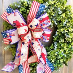 Stars and Stripes is the theme for this Patriotic Boxwood Wreath. Find it and others now in our Etsy shop. Fourth Of July Decor, 4th Of July Decorations, 4th Of July Wreath, July 4th, Rustic Americana Decor, Boxwood Wreath, Different Shades Of Green, Patriotic Wreath, Christmas Ribbon