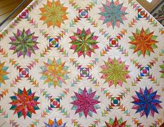 Awesome.  Harlequin Stars designed and pieced by Emma Jansen