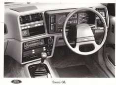 Ford Sierra GL dashboard (UK, 1985), Factory Press Photo. Ford Sierra, Ford Classic Cars, Old Fords, Ex Machina, Futuristic Cars, Dashboards, Ford Motor Company, All Cars, Press Photo