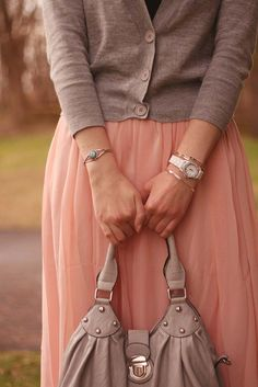 Pinner says: more fitted cardi over flowy skirt, cardi would need to be short-sleeved tho! :)