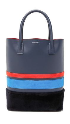 Plush shearling trim and bright suede stripes accent this smooth leather Mother of Pearl tote. Rolled double handles. Suede lined interior. Optional slim zip pouch. Dust bag included.