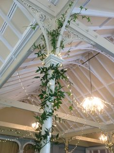 Green garlands as pillar decorations at The Old Swan Hotel, Harrogate - loose and unstructured, organic, wild and romantic. Ivy and ruscus. A Beamsley Blooms design.