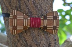 """A unique wooden bow tie is from several types of wood (maple, oak, cherry, mulberry) using sticking technique to create A """"Flannel"""" effect. The opposite side has a classic oak wood look. Wooden Bow Tie, Types Of Wood, Flannel, Cherry, Bows, Create, Classic, Unique, Accessories"""