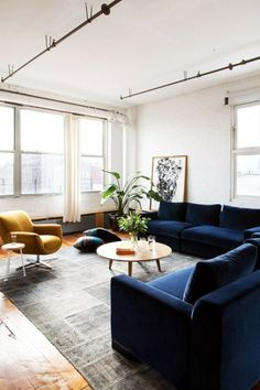 Inside an Insanely Stylish Williamsburg Loft A chic living space with a large blue sectional, a a yellow armchair Blue Couch Living Room, Living Room Sectional, New Living Room, Home And Living, Living Spaces, Living Room Ideas Navy Sofa, Blue And Mustard Living Room, Sectional Sofas, Lounges
