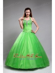 Cute Spring Green Sweet 16 Dress Halter Tulle Beading Ball Gown  http://www.fashionos.com    What a beautiful ball gown dress! It features a heavily embellished halter-style bodice and adorned by beadings the A-line may highlight your grace and temperament and will help you to be the princess on your party.