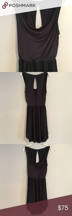 c3b0e3656ea0 Tank top built into the top. Layers of black crepe on the bottom. Longer in  the back.