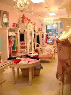 Fashion shop interior on pinterest shop interiors store for Baby shop decoration ideas