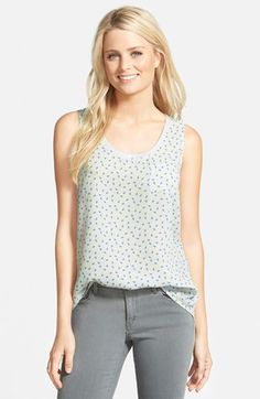 Free shipping and returns on Caslon® Scoop Neck Woven Tank (Regular & Petite) at Nordstrom.com. A light and breezy tank in a choice of fresh prints is detailed with ribbed knit trim around the neckline and a small chest pocket.