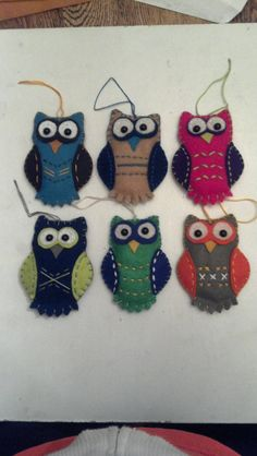 I made these felt owl ornaments using a pattern I found online and then modified to my liking. They are all hand stitched with embroidery yarn/floss and button eyes sewn on.