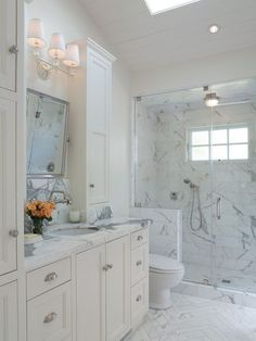 Single sink with flanking side wall cabinets - love this pretty bathroom!    Suzie: Annie Lowengart Design - Master bathroom with skylight, vaulted ceiling, seamless glass ...