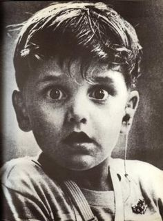 The face of a boy hearing the sounds of the world for the first time. The photo was taken by photographer Jack Bradley, & depicts the exact moment this boy, Harold Whittles, hears for the very first time ever. The doctor treating him has just placed an hearing aid in his left ear. Date unknown.