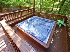 Amberwood -- Take a long hot soak in the extra large sunken hot tub located on the spacious deck or just sit back and rock the evening away in the rocking chairs located on the covered private deck.