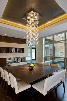 Contemporary Dining Room with Hardwood floors, Gilt ceiling, Particle Chandelier Bubble Chandelier, High ceiling, Chandelier