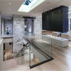 Like the open space, stone cladding, glass railings and wooden floors. Comes together for a modern look