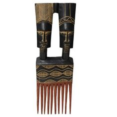 Ashanti Two-headed Wooden Comb - Handcrafted in Ghana by African Heritage Collection. $34.95. Illustrates the power of seeking advice and positive thinking. An attractive to excite your wall. Nice antique finish. Hook for hanging. Imported from Ghana Carved by talented artisan Olu