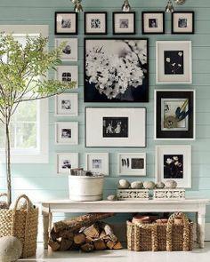 I like the way these framed pictures are arranged. Love the style too. Accent wall with black/white pictures and frames. *** DIY home decor.
