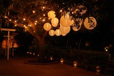 Festoon lights, hanging nylon lanterns, vintage-style lanterns at Northbrook Park, Nr Farnham, Surrey by www.stressfreehire.com #venuetransformers #midsummernightsdream #summerparty