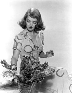 Bette Davis Arranging Flowers