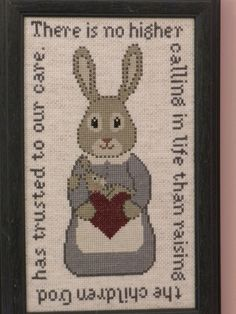 Cross-stitched mother rabbit with bunny.  There is no higher calling in life than raising the children God has trusted to our care.