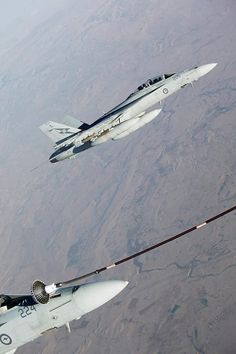 Two Royal Australian Air Force (RAAF) F/A-18F Super Hornets conduct refuelling operations from a RAAF KC-30A Multi Role Tanker Transport over Iraq. Australia's Air Task Group (ATG) consisting of six Royal Australian Air Force (RAAF) F/A-18F Super Hornets, an E-7A Wedgetail Airborne Early Warning and Control aircraft and a KC-30A Multi-Role Tanker Transport aircraft continue to support Operation OKRA with missions in Iraq.