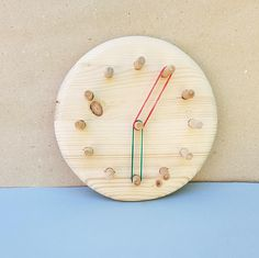 Clock shape Geo Board  The handmade Montessori pine wood geoboard is one of the most beneficial materials in a Montessori classroom and home. Organic hardwood Geo board is a great learning as well as sensory toy for kids aged 2+. Geoboard is board with pins, on which you can create different shapes and figures with rubber bands. The child will need to concentrate on stringing bands and building figures.  Playing with this toy helps to promote creativity, fine motor skills and it is a great…