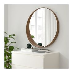 domino mag: Mid-Century Modern On a Budget: Ikea Stockholm Mirror Decor, Ikea Mirror, Mid Century Modern Style Furniture, Small Shelves, Walnut Veneer, Ikea, Round Mirror Bathroom, Stockholm Mirror, Ikea Stockholm