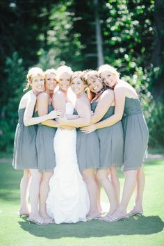 Skyler chose for her bridesmaids to be in this matching light grey gown and all five of them look adorable.  If you are having a summer wedding, keep the colors light and airy like she did, and you are sure to have amazing framable photos. Photos by Clane Gessel Photography | #weddings #photography #bridesmaids