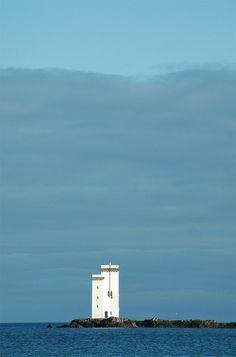 Carraig Fhada lighthouse under dark skies, Isle of Islay