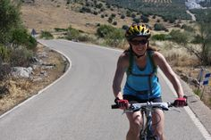Riding in the sun.Cordoba countryside road, Andalucia