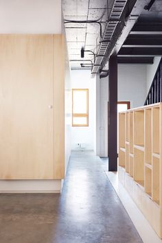 Project 12 Architecture has used plywood partitions and furnishings to reconfigure a converted warehouse in Melbourne.