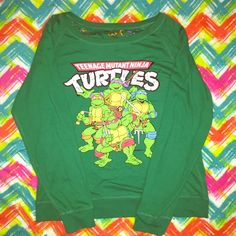 Teenage Mutant ninja turtles reversible sweater L Still looks new. Size L. For women big to wear with leggings and can pull on one side to show a little skin. for men y'all know how to roll with yalls style lol. It's reversible so wear it one either side u want. Excellent condition Teenage mutant ninja turtles Sweaters