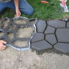 I so want to do this to my backyard: have a nice path out of pretend cobblestones