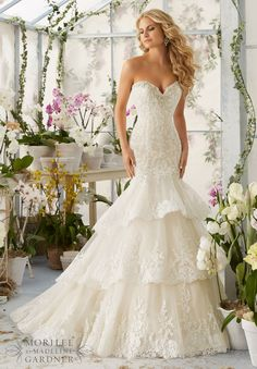 """Wedding Dresses and Wedding Gowns by Morilee featuring Crystal Moonstone Beading Meets Alencon Lace Appliques and Scalloped Edging onto the Tiered Tulle Gown Removable Spaghetti Straps. Available in Three Lengths: 55"""", 58"""", 61"""". Colors available:White/Silver, Ivory/Silver, Light Gold/Silver"""