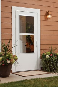 A traditional Larson Storm Doors looks great paired with some fun flower pots!