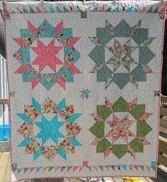 Swoon with sashings, mini star, and 2 borders from leftover HSTs of the flying geese