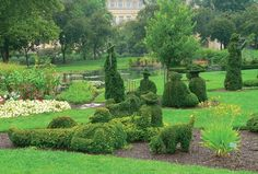 """Downtown Park in Columbus, Ohio.  Topiaries shaped to resemble characters in Seurat's """"A Sunday Afternoon on the Island of La Grande Jatte.""""  Lovely!"""
