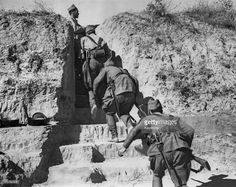 Spain - 1936. - GC - Republican troops of the International Brigades moving into a communications trench at Navalcarnero, near Madrid, at the beginning of the…