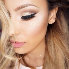 Perfectly matched eyebrow pencil that is just a shade above the darkest colour of her hair