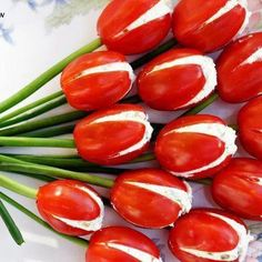 Tulip Tomatoes  Ingredients:  Cherry tomatoes (Romas are just too big), cut criss cross 12-24 stalks of green onion 1-2 , 8oz pkg cream cheese Dill to taste Diced cucumber  Directions:  Mix cream cheese, dill and cucumber together. You could optionally slice up some green onion for the mix. Stuff cherry tomatoes, put in fridge to chill, 1 hour. Cut small hole in bottom to insert green onion, lay on tray as edible decoration for any spring or summer party.