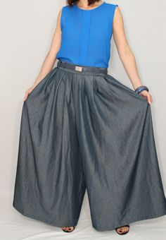 Amazing palazzo pants are looking like skirt.  They designed with pleated extra wide leg pants, elastic band on back for sure and comfortable fit.