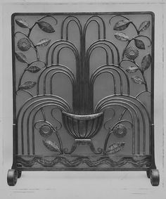 """La Fontaine"" (""The Fountain"") Fire Screen by Edgar Brandt  Circa 1924.  The use of leaves is a typical art deco feature, along with the use of stainless steel."