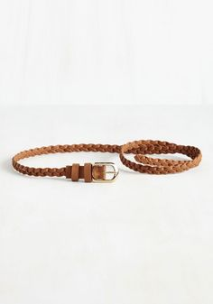 Cinch Is It! Belt in Cognac. This vegan faux-leather belt is stepping up to the plait, ready to serve up a ton of fab outfits! #brown #modcloth